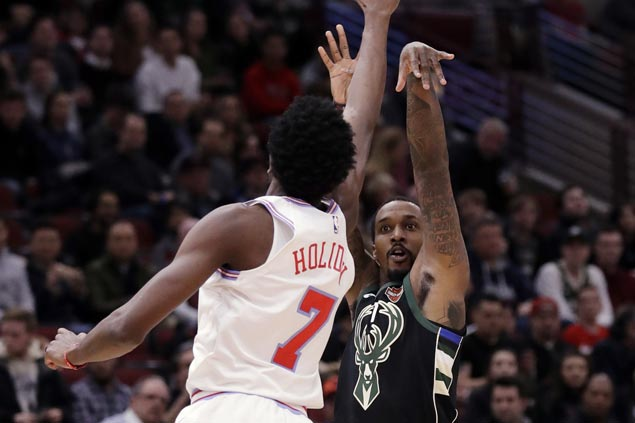 Bucks overcome poor start to beat Bulls, move within a half-game of seventh-place Miami in East