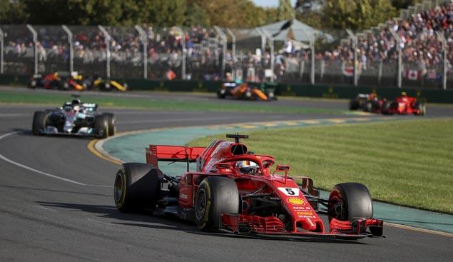 Sebastian Vettel holds off Lewis Hamilton to win Aussie GP in dramatic start to new F1 season