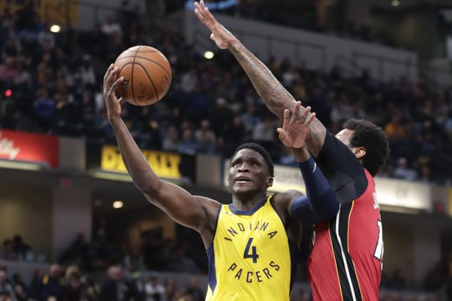 Pacers secure playoff berth with overtime win over Heat