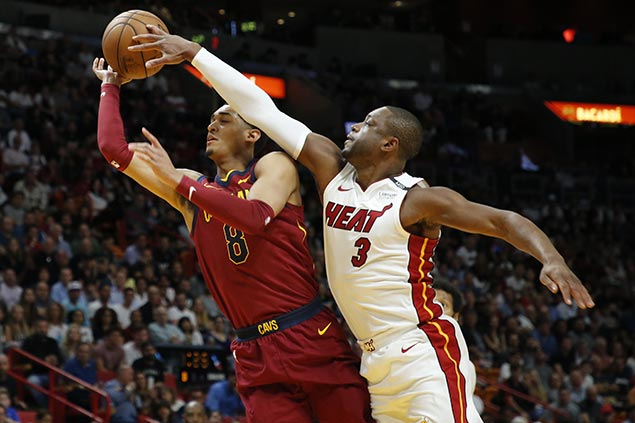 Wade throws block party as stifling Heat defense, Love early exit leave Cavs in disarray