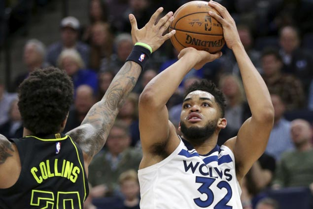 Karl-Anthony Towns scores franchise-record 56 as Wolves down Hawks to boost playoff bid
