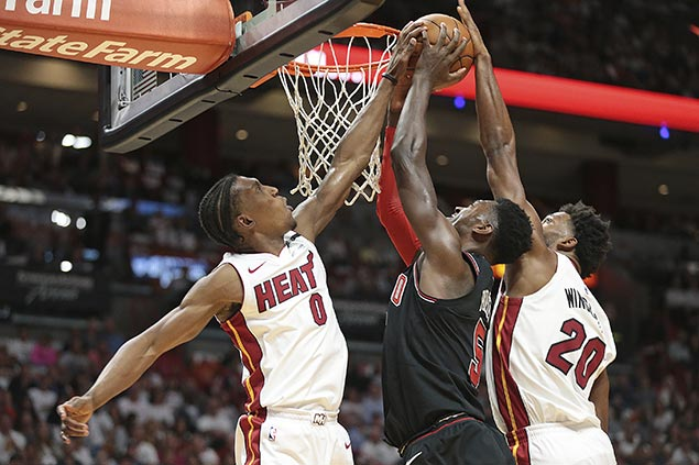 Heat move a win away from clinching playoff spot with romp over lowly Bulls