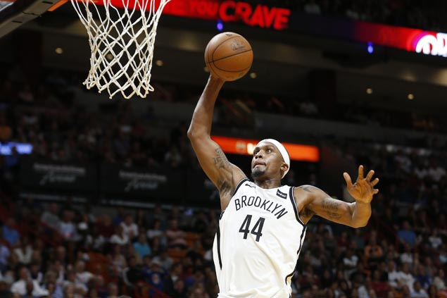 Nets win in overtime to keep Heat from securing playoff spot