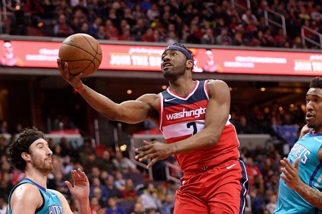 John Wall solid in return from injury layoff as Wizards down Hornets to clinch playoff berth