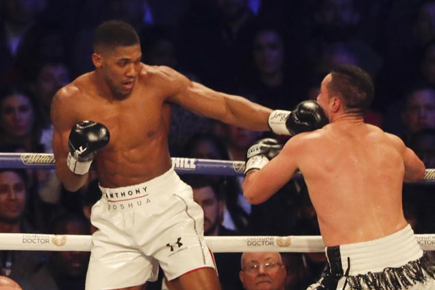 Anthony Joshua unifies three heavyweight world titles with decision over Joseph Parker