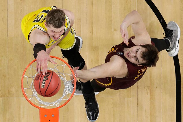 Moe Wagner and Michigan sustain charge to gain national final and halt Loyola's Cinderella run