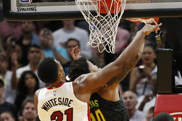 After controversial statements, Whiteside lets game do the talking as Heat secure playoff spot