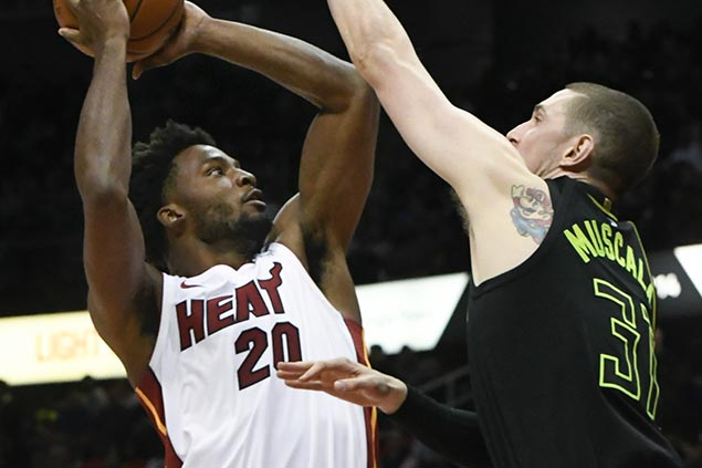 Hot-shooting Heat ride second quarter surge to assert mastery over Hawks