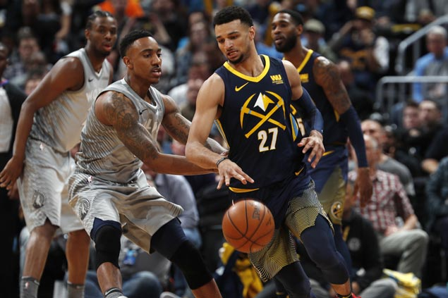 Balanced Nuggets overcome Timberwolves to boost playoff bid