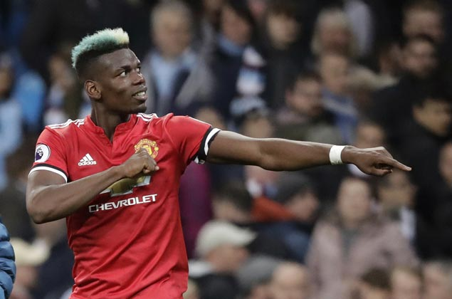 Paul Pogba stars as United puts City title celebration on hold with huge derby win