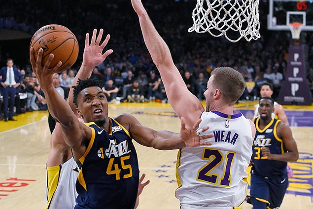 Jazz cruise past Lakers to clinch playoff spot in wild Western Conference