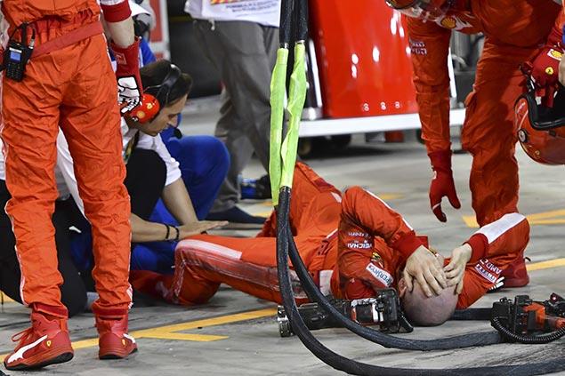 Vettel tops tense Bahrain GP as Ferrari mechanic breaks leg in pit stop accident