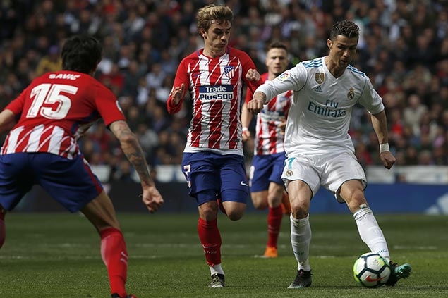 Griezmann matches Ronaldo as Atletico earns draw with Real in Madrid derby