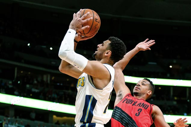 Nuggets keep playoff hopes alive with comeback win over Trail Blazers