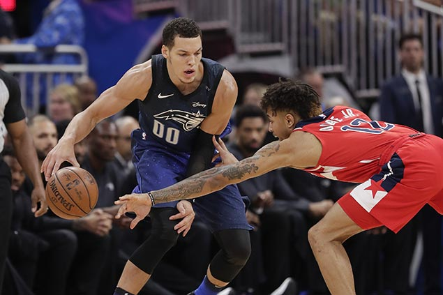 Magic pulls away late as cold-shooting Wizards fall to eighth in East