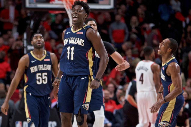 Holiday scores playoff-high 33, Rondo flirts with triple-double as Pelicans down Blazers to go 2-0