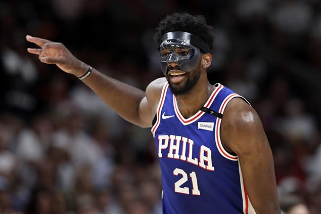 Embiid makes winning playoff debut, powers late surge as Sixers regain control over Heat