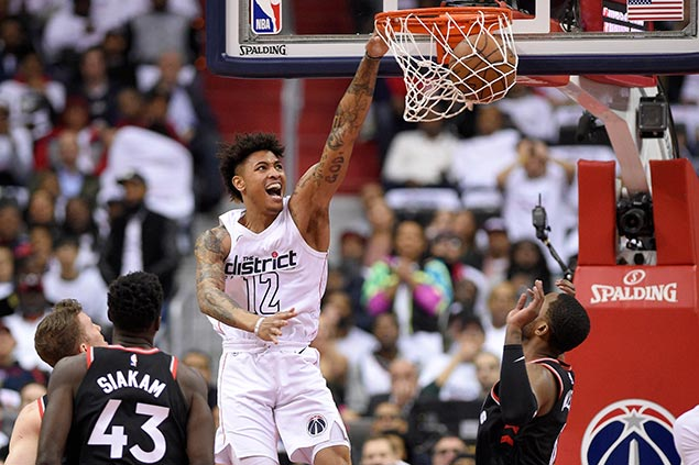 Wizards bounce back strong to tame Raptors in heated Game Three
