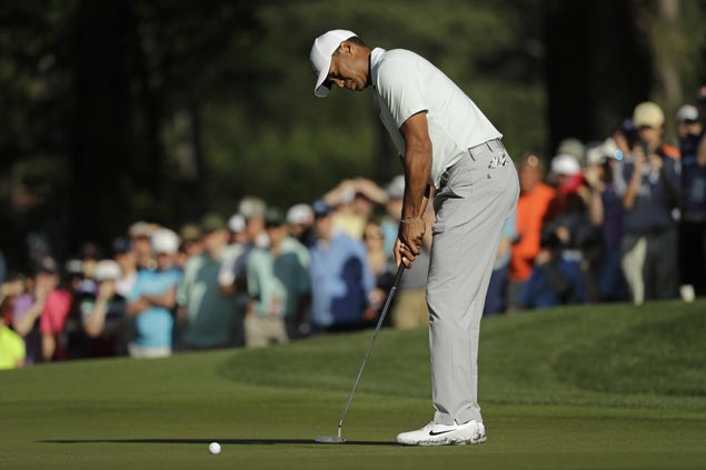 Tiger Woods continues to struggle on Quail Hollow greens but birdies final hole to stay inside cut line