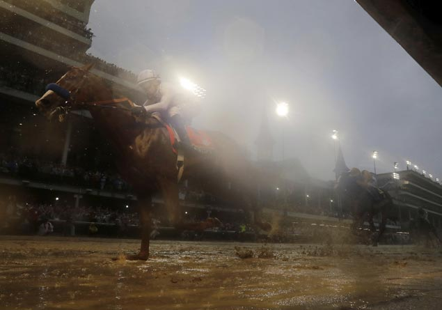 Justify splashes though the slop to win Kentucky Derby and keep record unblemished