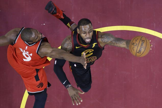 LeBron James hits last-gasp basket as Cavs nip Raptors to close in on East finals