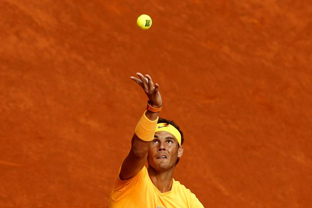 Rafael Nadal sustains fine form on clay as Novak Djokovic makes another early exit