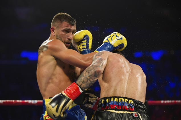 Lomachenko stops Linares in 10th round of lightweight bout to bag title in his third weight class