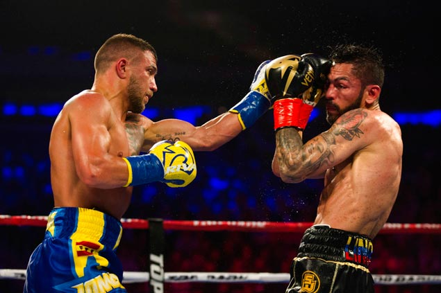 Lomachenko keeps his promise by surviving knockdown to stop tough Linares in 10th