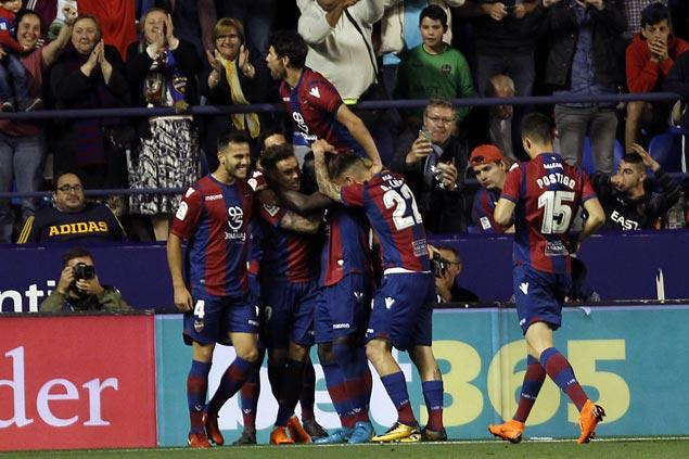 Levante wins wild game to end Barcelona's bid for unbeaten Liga season