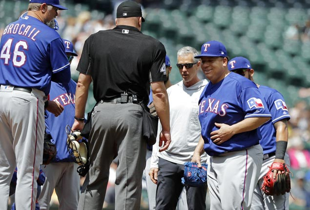 Bartolo Colon shrugs off line drive to belly, powers Rangers to big win over Mariners