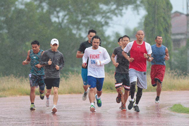 Heavy downpour can't stop Manny Pacquiao training for Matthysse fight