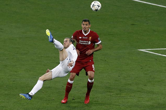 Gareth Bale scissor-kick highlights Madrid rout of Liverpool for third straight Champions League title