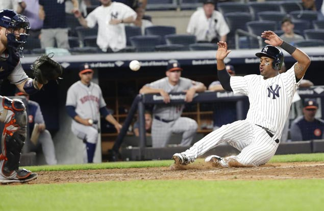 Yankees overcome five errors to beat Astros in 10 innings