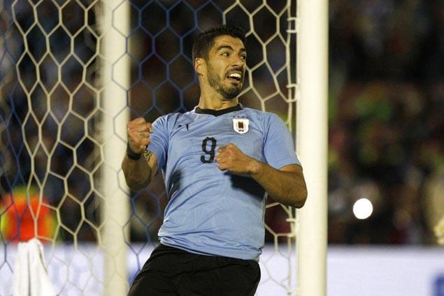 Banished four years ago, Uruguay star Luis Suarez seeks World Cupredemption