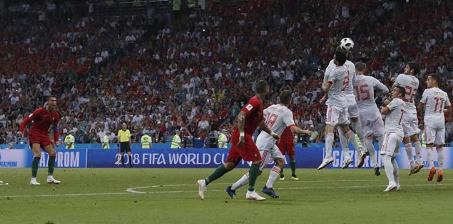 Ronaldo nets hat trick as Portugal earns draw with embattled Spain in World Cup