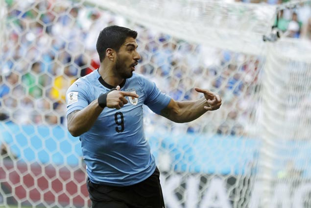 Suarez scores in 100th game for Uruguay, sends La Celeste past Saudi Arabia and into last 16