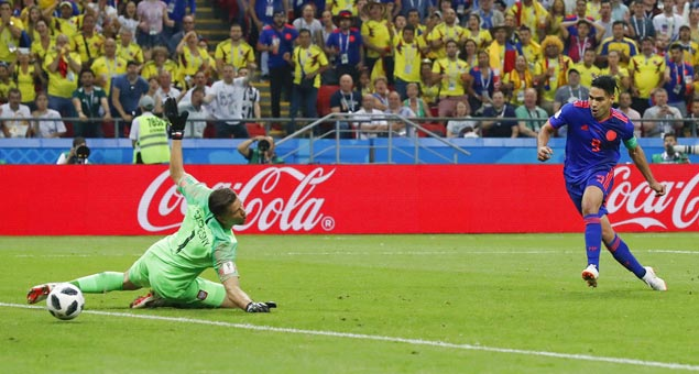 Radamel Falcao nets first World Cup goal as Colombia eliminates Poland
