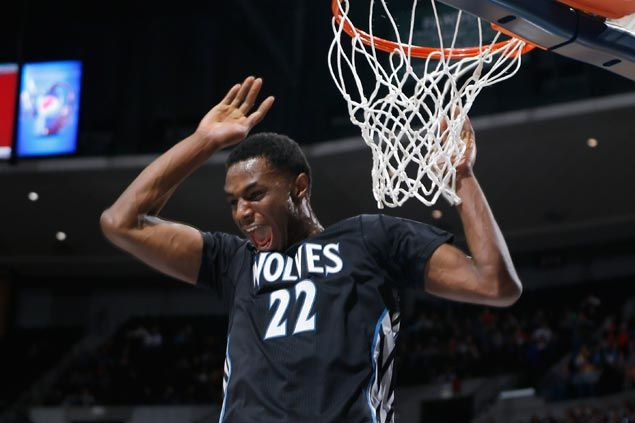 Andrew Wiggins goes for a reverse, one-hand, 720-degree dunk - and nearly makes it. WATCH