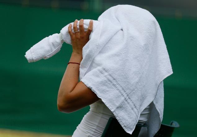 Ball boy collapses, dozens of fans treated for heat-related illnesses as temperatures soar at Wimbledon