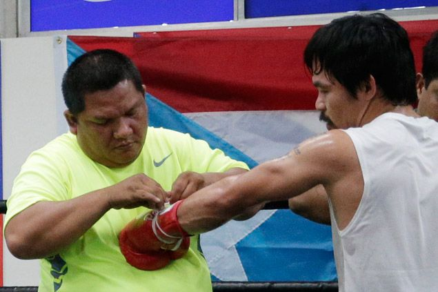 As Pacquiao reaches for crowning glory, pal Buboy Fernandez marvels at how far they've come