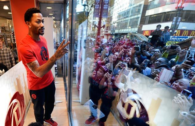 Bulls star Derrick Rose shares day with young fans in launch of signature shoe