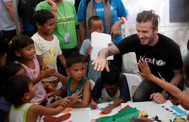 Touching gesture as global icon Beckham brings cheer to typhoon victims