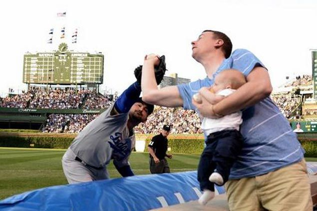 Man carrying 7-month old baby steals foul ball from Adrian Gonzalez