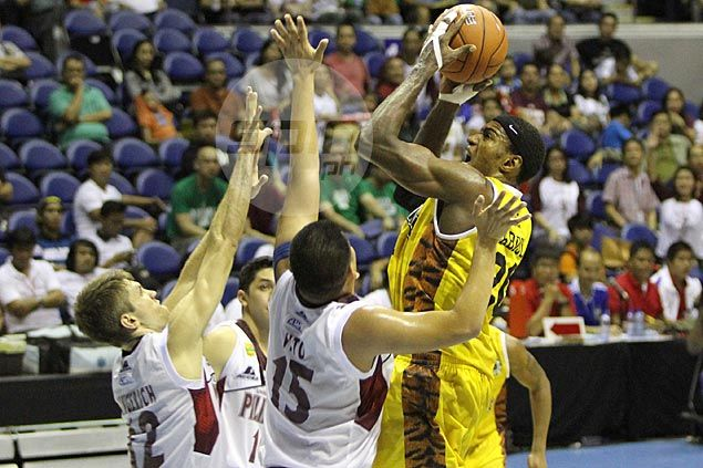 UST trio of Abdul, Vigil, Mariano rallies Tigers past hard-luck UP Maroons