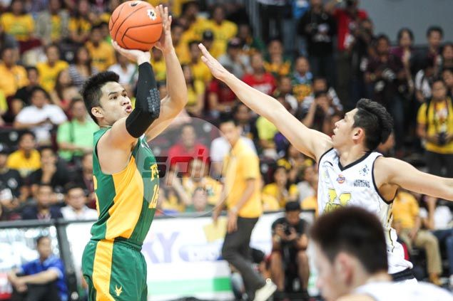 FEU Tamaraws super subs hold off late UST Tigers fightback in Game One of UAAP Finals
