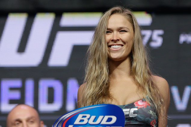Ronda Rousey keeps promise, leaves UFC title belt with Brazil judo school after beating Correia