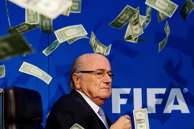 WATCH Sepp Blatter showered in fake money by British comedian during Fifa news conference