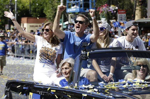 Warriors head coach Steve Kerr rides with his family during the victory parade. AP