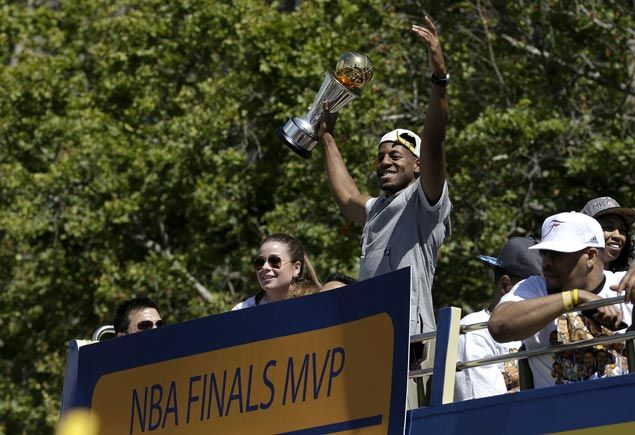 Golden State forward Andre Iguodala holds up the NBA Finals MVP trophy during the Warriors championship parade in Oakland. AP