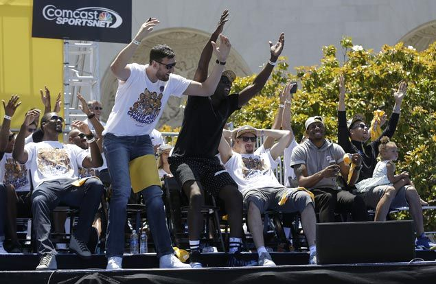 Golden State Warriors center Andrew Bogut and forward Draymond Green stand up as teammates react during the celebrations. AP